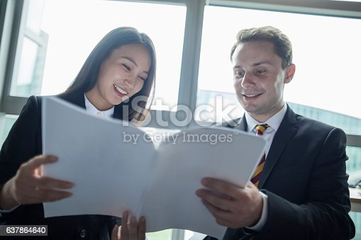 istock Education consultant with Chinese students in office 637864640