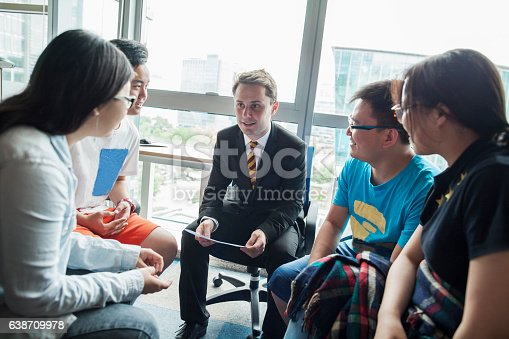 istock Education consultant with Chinese students in office 638709978