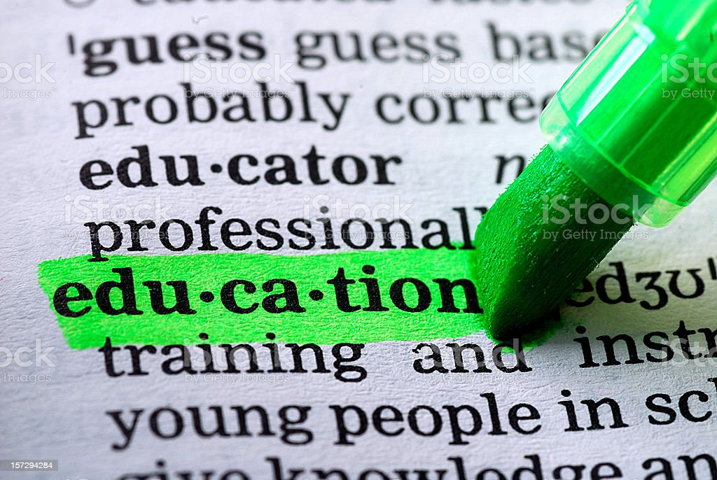 education definition highlighted in dictionary stock photo