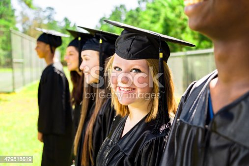 istock Education: Diverse group of friends at graduation. Cap and gown. 479518619