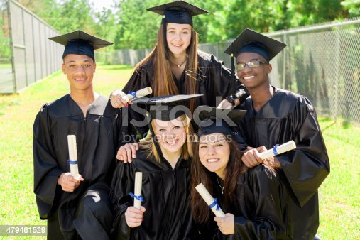istock Education: Diverse group of friends at graduation. Cap, gowns, diplomas. 479461529