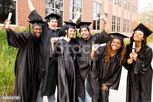 istock Education: Diverse group of friends excited after college graduation. Diplomas. 536506795