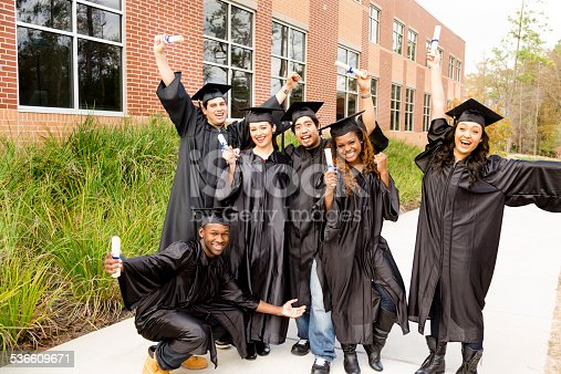 istock Education: Diverse group of friends excited after college graduation. Diplomas. 536609671