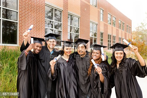 istock Education: Diverse group of friends excited after college graduation. Diplomas. 537174497