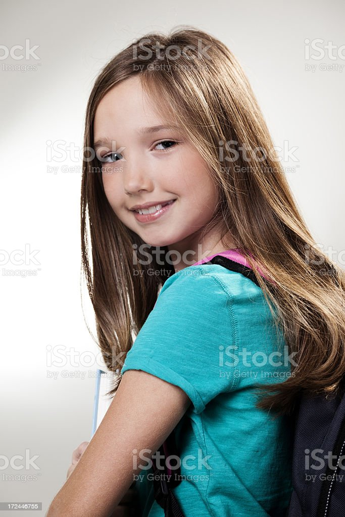 Education:  Elementary age student with books and backpack royalty-free stock photo