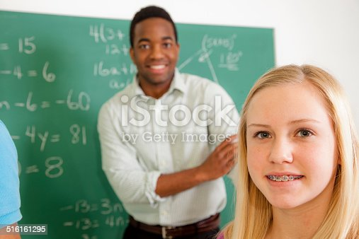 157687202 istock photo Education: Female student and teacher in school math class. 516161295