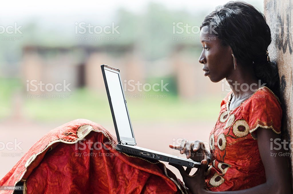 Education for Africa: Technology Symbol African Woman Studying Learning Lesson stock photo