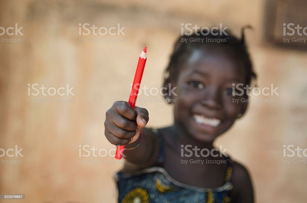 Education for African Children: Little Girl Showing Pencil stock photo