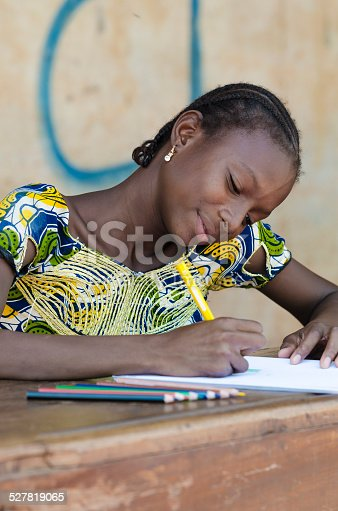 911029592 istock photo Education for African Children: Writing Letters With Color Pencils 527819065