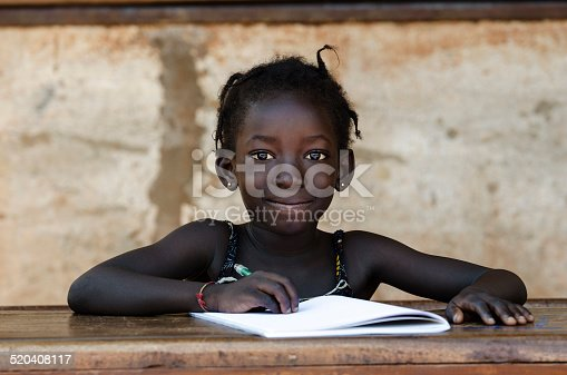 istock Education: Gorgeous Portrait Of Traditional African School Girl Writing Letter 520408117