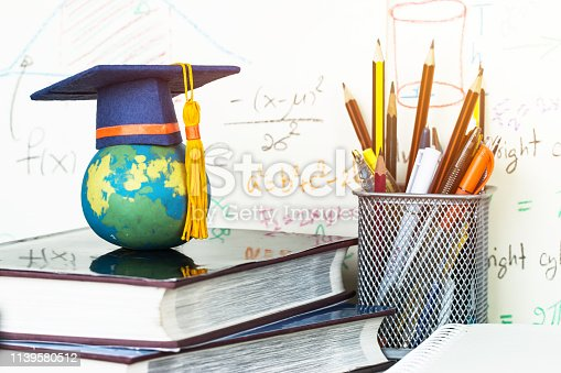 959387240 istock photo Education Graduate study concept: Graduation hat on pencils with formula arithmetic equation graph on near global model at university classroom. Ideas for knowledge learning success, Back to School 1139580512