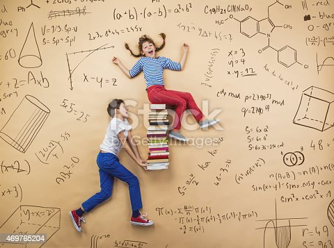 istock Education image of two schoolchildren on a math background 469765204