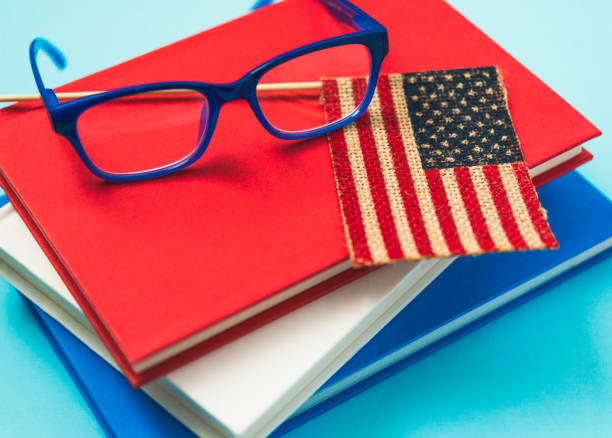 984fcfe5469b Education in America. Books and eyeglasses with American flag stock photo