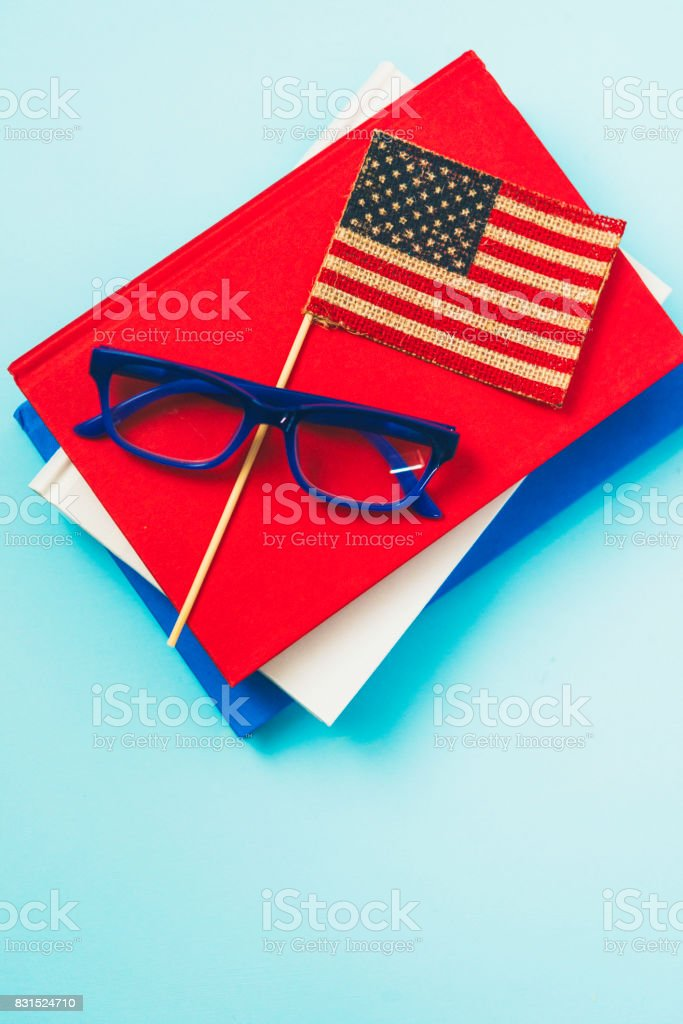 40dd8b6dd0c4 Education in America. Books and eyeglasses with American flag royalty-free  stock photo