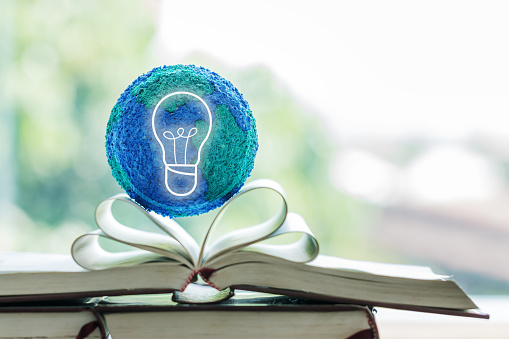 istock Education in future creative learning study on international educational projects. Open textbook with globe model with light bulb. Concept of reading or thinking innovation for knowledge in university 1157932543