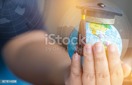 959387240 istock photo Education in Global, Graduation cap on Businessman holding Earth globe model America map with Radar background in hands. Concept of global business, abroad educational, Back to School. 927614006