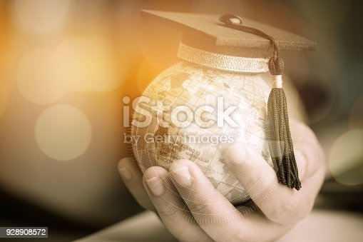 959387240 istock photo Education in Global, Graduation cap on Businessman holding Earth globe model map with Radar background in hands. Concept of global business, abroad educational, Back to School. 928908572