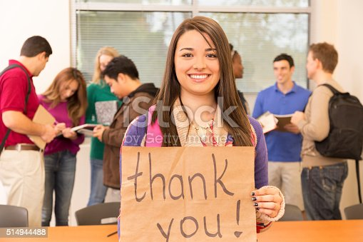 istock Education: Latin descent college student holds 'Thank you' sign. Classroom. 514944488