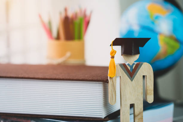 education learning concept, university knowledge achievement for study abroad international, alternative studying idea. Models graduation celebration pencils box background, Back to School. stock photo