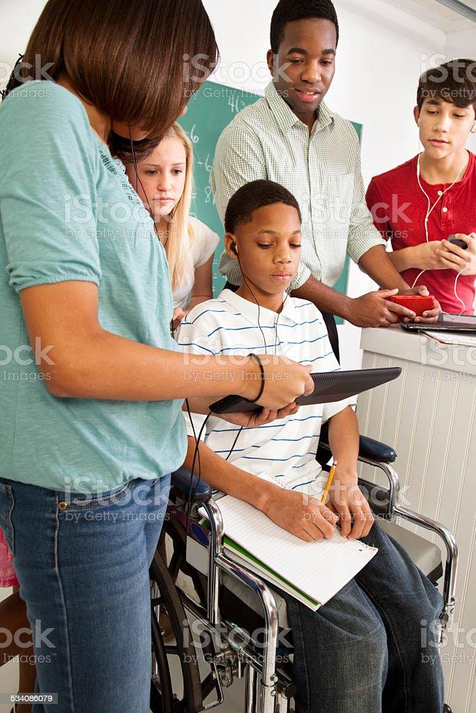 Education: Math students, teacher. School, classroom. Technology, disability. stock photo
