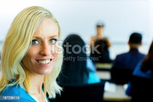 istock Education:  Mature student in lecture hall with professor background. 187236115