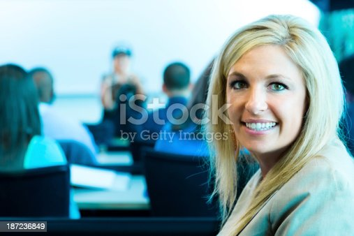 istock Education:  Mature student in lecture hall with professor background. 187236849