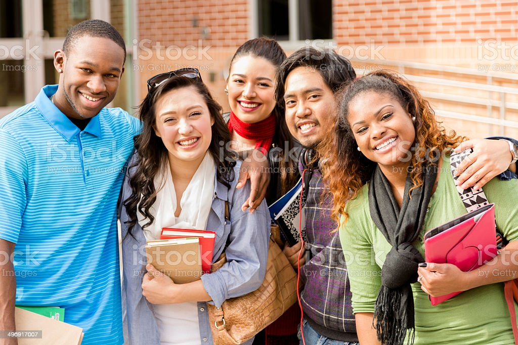 Education: Multi-ethnic college friends hang out before class. stock photo