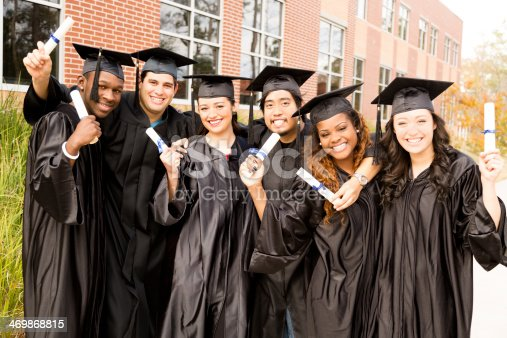 istock Education: Multi-ethnic friends excited after college graduation. 469868815