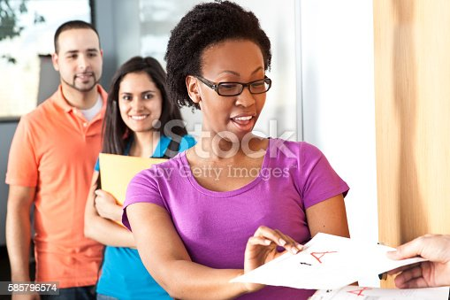istock Education: Multi-ethnic group of college students in classroom. 585796574