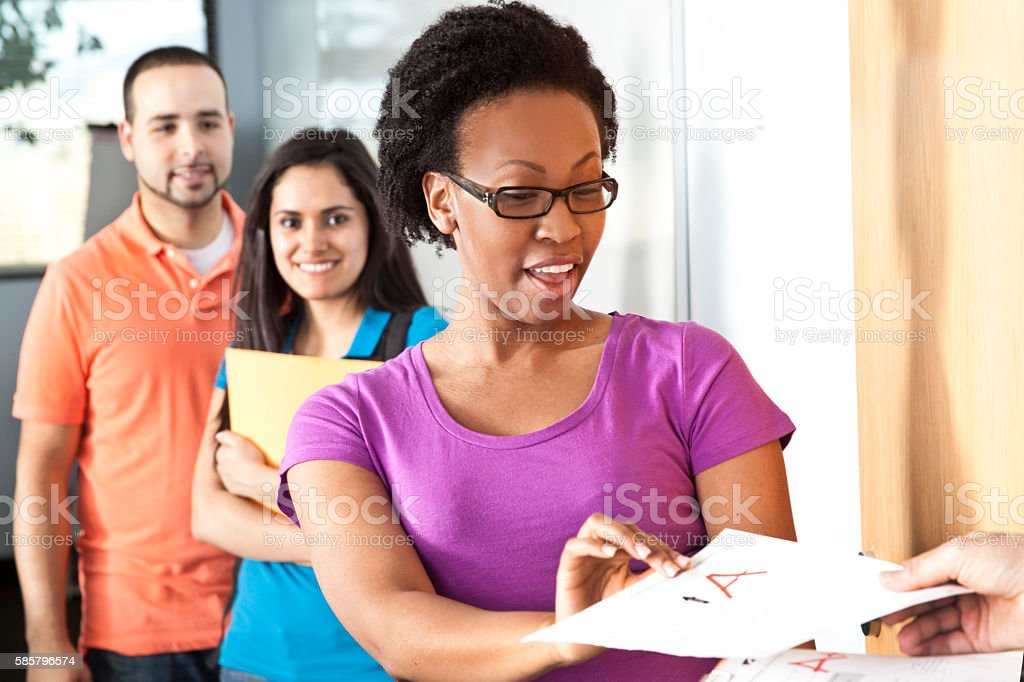 Education: Multi-ethnic group of college students in classroom. stock photo