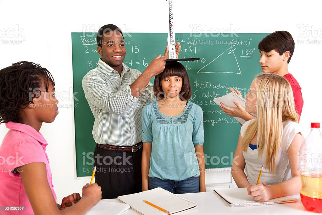 Education: Multi-ethnic, teenage math students and teacher. School, classroom. stock photo