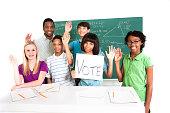 istock Education: Multi-ethnic, teenage math students and teacher. Vote. School, classroom. 534085377