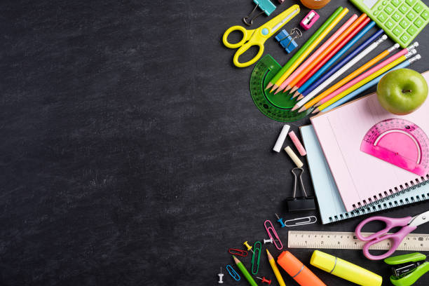 Education or back to school Concept. Top view of Colorful school supplies with books, color pencils, calculator, pen cutter clips and green apple on chalkboard background. Flat lay. Education or back to school Concept. Top view of Colorful school supplies with books, color pencils, calculator, pen cutter clips and green apple on chalkboard background. Flat lay. school supplies stock pictures, royalty-free photos & images