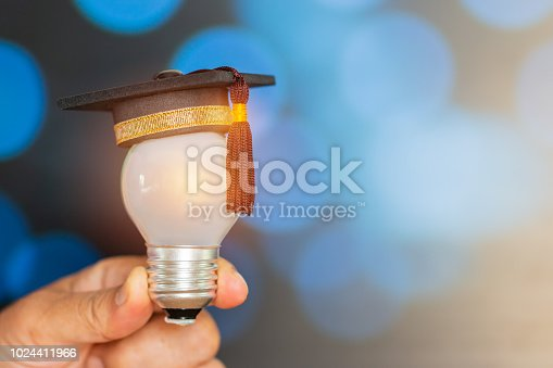 istock Education or Graduate study Creative concept: Mini Graduated hat with light bulb on Hands in light background. Ideas with innovation creativity for Educational successs studies world, back to School 1024411966