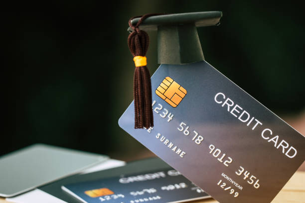 education payment credit card for study graduate concept: graduation cap on mock up card, idea for dept loan playing for successs studying or business have to use so money and alternative risk finance - dept stock pictures, royalty-free photos & images