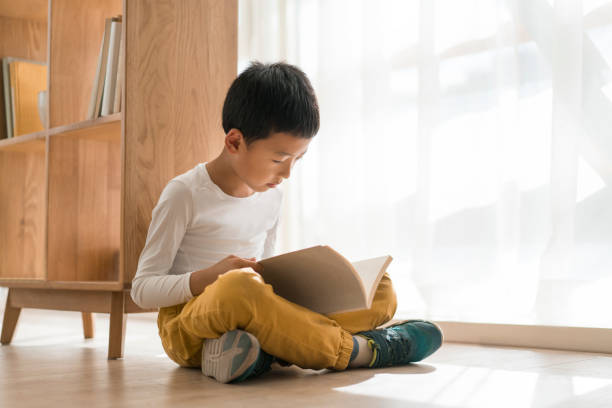 education Reading boy 8 9 years stock pictures, royalty-free photos & images