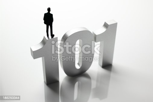 Education concept. Plastic toy businessman standing on top of block letter word - 101.Similar images -