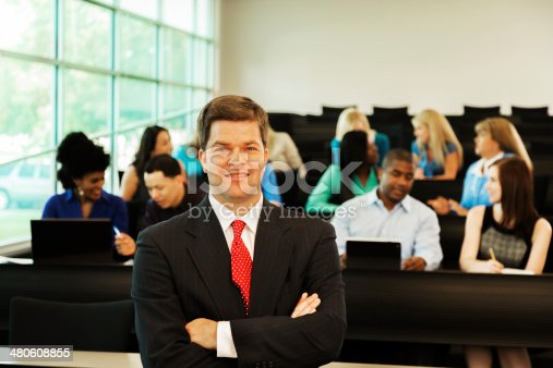 istock Education: Professor with college students in lecture hall. 480608855