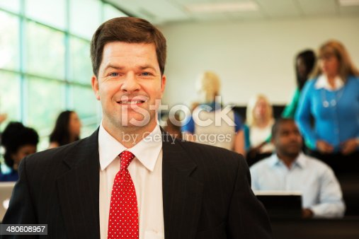 istock Education: Professor with college students in lecture hall. 480608957