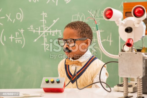 istock Education:  Retro revival boy making robot in science lab. 452669117