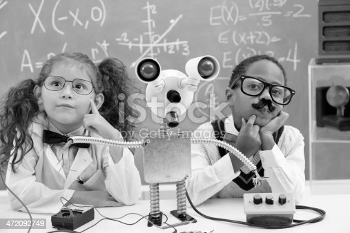 istock Education:  Retro revival children making robot in science lab. 472092749