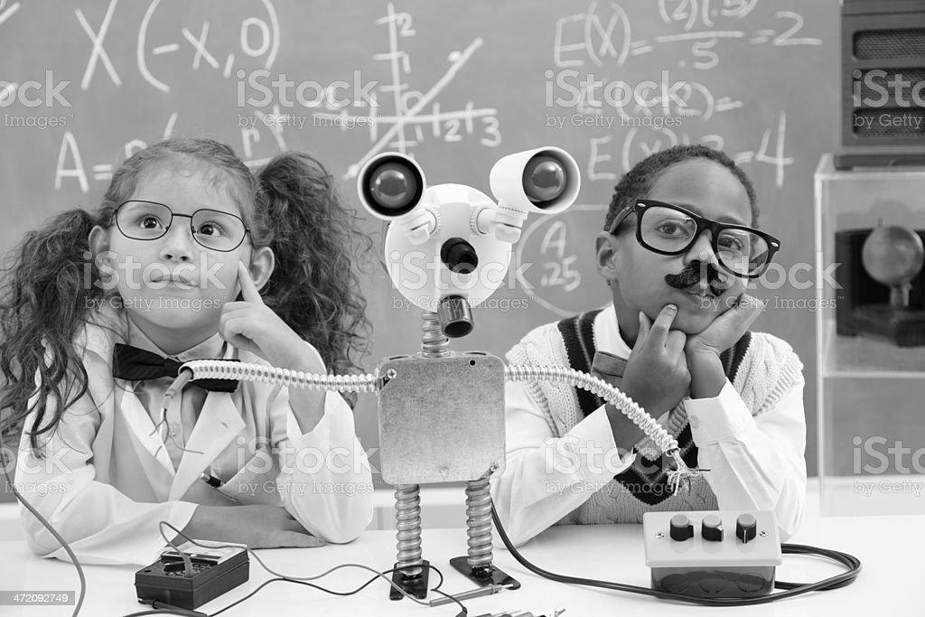Education:  Retro revival children making robot in science lab. stock photo