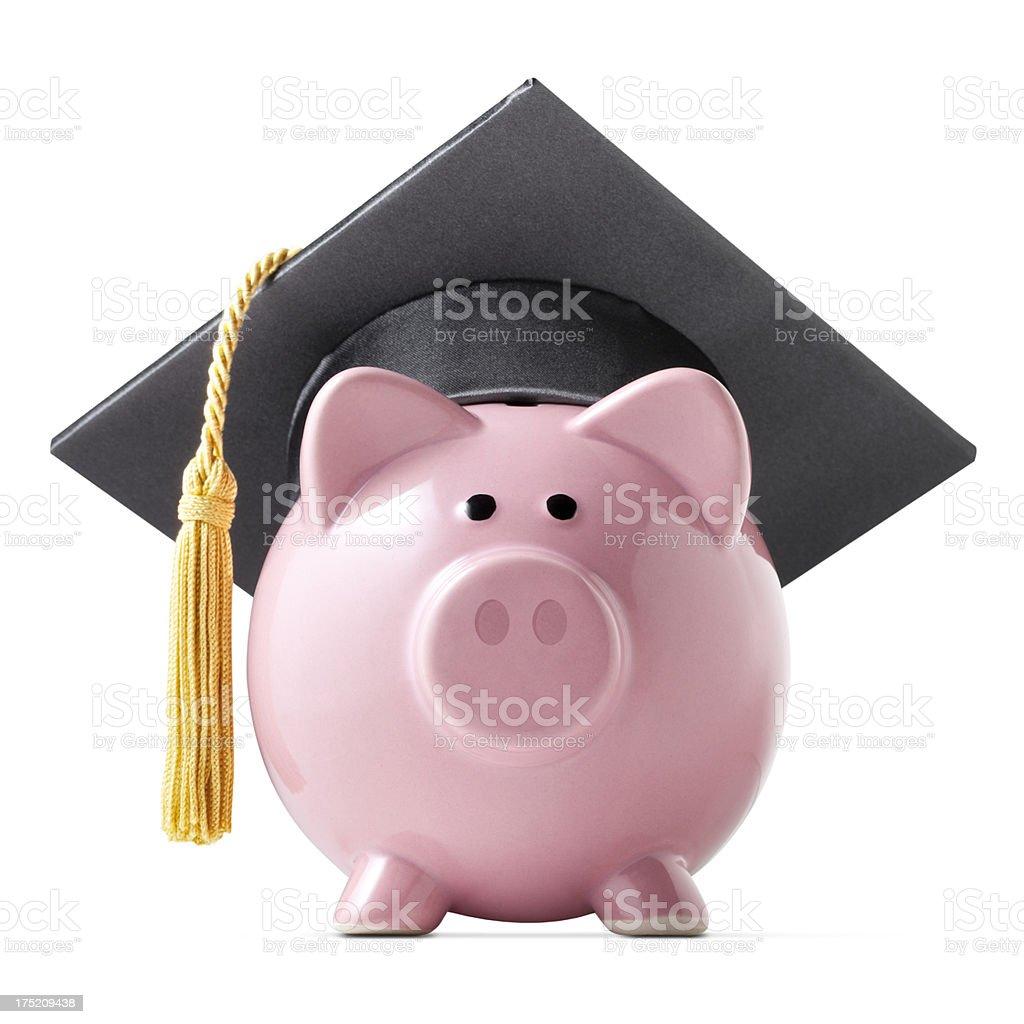 Education savings. Piggy bank with graduation cap. stock photo