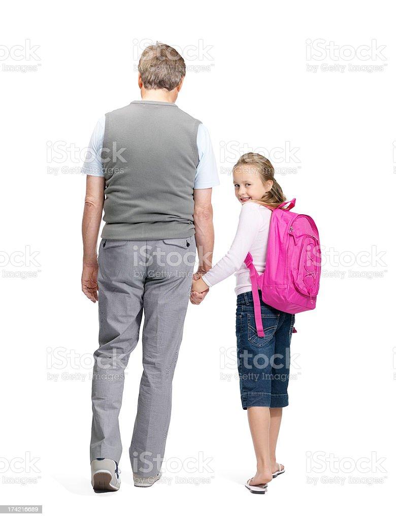 Edukacja-mała dziewczynka idzie do szkoły z jej Dziadek – zdjęcie