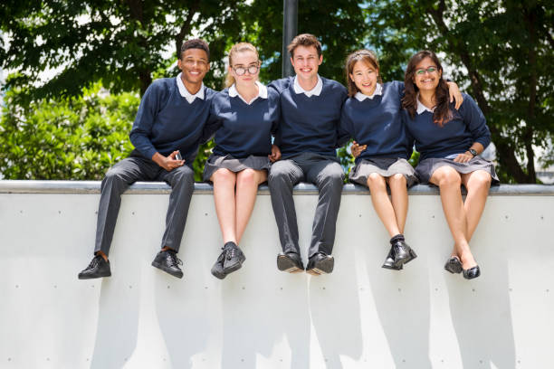 education students people knowledge concept - uniform stock photos and pictures