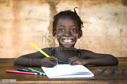 istock Education Symbol: Big Toothy Smile on African School Girl 522079935