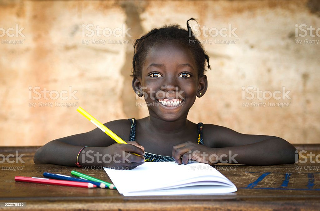 Education Symbol: Big Toothy Smile on African School Girl stock photo