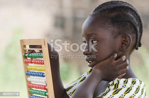istock Education Symbol: Little African Girl Learning to Count with Game 492552716