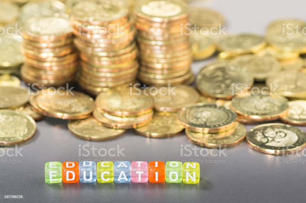 Education text and coins Lizenzfreies stock-foto