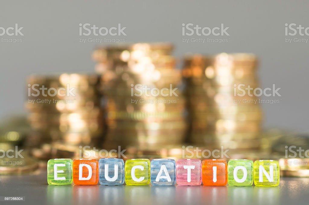 Education text and coins photo libre de droits